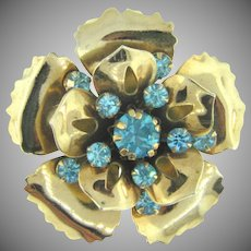 Vintage gold tone flower Brooch with blue rhinestones