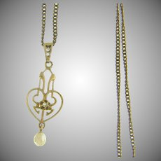 Small lavalier 10kt gold pendant with fresh water pearl drop and tiny diamond