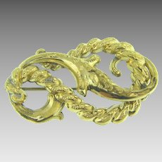 Early gold filled Brooch in an abstract swirling design