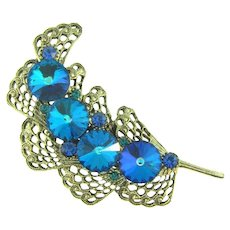 Unusual 1960's feather designed Brooch with rivoli blue rhinestones