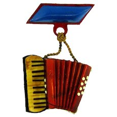 Marked made in Italy early celluloid figural souvenir accordian Brooch