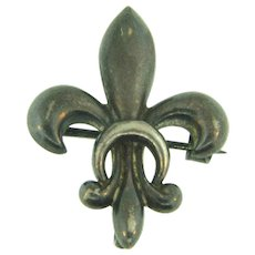 Early sterling Watch Pin in a fleur- de- lis design
