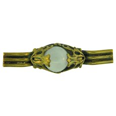Early gold tone Bar Pin with center opaque glass cabochon