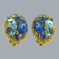 Mark made in Austria clip back rhinestone Earrings in blue tones