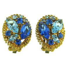 Mark made in Austria clip back rhinestone Earrings in blue tones