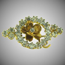 Small early gold tone Scatter Pin with a center flower and crystal rhinestones