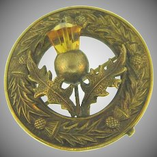 Vintage early Scottish thistle themed Brooch with faceted amber glass bead