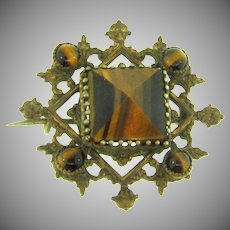 Early gold tone Brooch with tiger eye stones