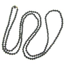Vintage 46 inch faceted black glass small bead Necklace