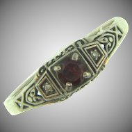 Marked Sterling and Vintage size 8 ring with garnet and tiny diamonds