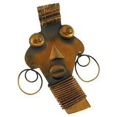Signed Rebaje copper African themed Brooch