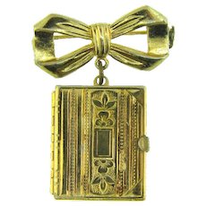 Vintage gold tone bow Pin with six picture Locket