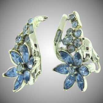 Signed Coro clip back Earrings in a floral design with blue rhinestones