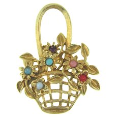 Vintage figural flower basket Brooch with multicolored glass stones