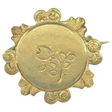Early gold filled circular Brooch with chased floral design