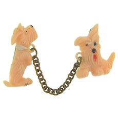 Early plastic chatelaine Brooch of pink scottie dogs