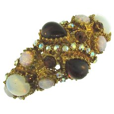 Vintage clamper Bracelet with opaque, AB, opalescent and dark topaz glass stones