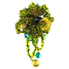 Signed Eugene gorgeous rhinestone and beaded Brooch in green tones