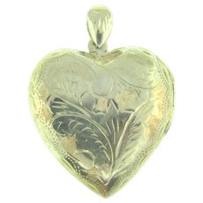 Marked 925 silver large heart shaped Locket with chased design