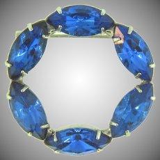 Vintage circular rhinestone Brooch with blue stones