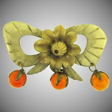 Vintage early plastic bow and flower Brooch with dangling amber glass balls