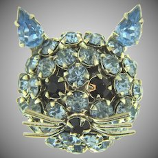 Signed Warner figural cat face Brooch with blue rhinestones