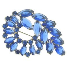 Vintage rhinestone Brooch in an abstract design with shades of blue stones
