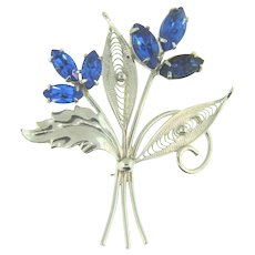 Marked sterling filigree Brooch with deep blue rhinestones