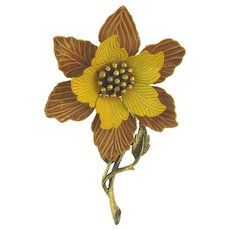 Signed Hedy enamel flower Brooch with gold tone center and stem
