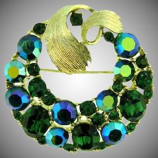 Signed Lisner circular Brooch with green and green AB rhinestones