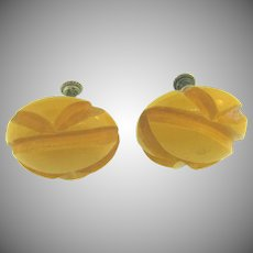 Bakelite screw on deeply carved circular Earrings