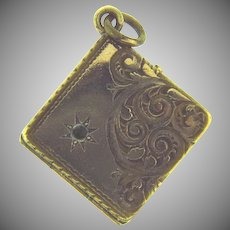 Vintage small square gold filled Locket with chases design and red paste stone