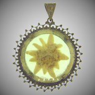 Vintage early Pendant with dried flower under celluloid