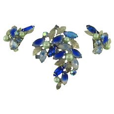 Signed Kramer (on earrings only) Brooch and clip back Earrings with blue tone rhinestones and imitation pearls