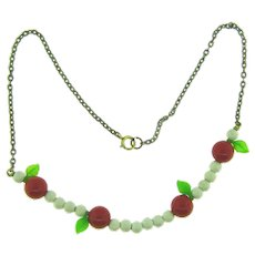 Vintage choker Necklace with composition beads, red plastic beads, green plastic leaves