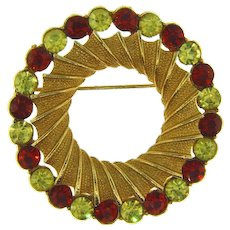 Signed Coro circular gold tone Brooch with topaz and citrine rhinestones