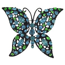 Vintage large figural butterfly Brooch with blue and green rhinestones in a japanned finish frame