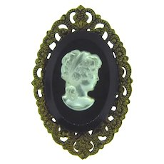Stamped West Germany small filigree Brooch with glass cameo