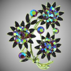 Signed Lisner floral Brooch with red AB rhinestones and black enamel