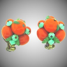 Vintage clip back Earrings with orange glass beads and mint green accents