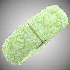 Vintage white celluloid carved floral clamper Bracelet