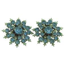 Vintage 1950's snowflake clip back Earrings with blue rhinestones