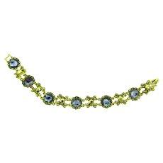 Signed Napier gold tone link Bracelet with purple glass stones
