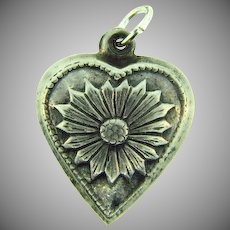 Stamped sterling repousse puffy heart Charm with daisy