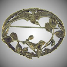 Marked sterling silver oval Brooch with floral and bird design
