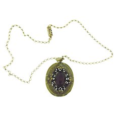 Vintage pendant Necklace with recessed purple glass stone