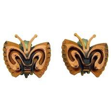 Signed Renoir copper figural  butterfly clip back Earrings