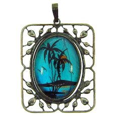 Vintage butterfly wing Pendant with a reverse painted tropical setting