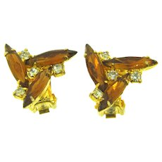 Vintage small rhinestone pinwheel clip back Earrings with amber and crystal stones