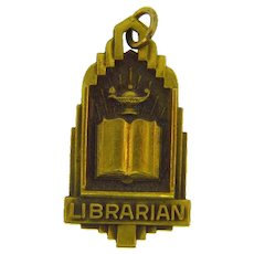 Marked H.J.Co. Art Deco Librarian pendant